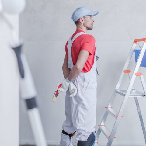 Room Painter and His Job. Apartment Remodeling Concept.